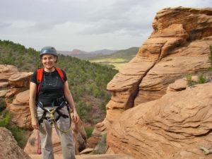 Carol Matz rappelling in Utah
